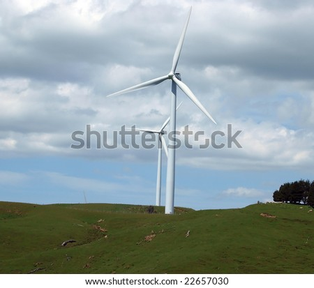 Wind Turbines dwarf the hills they stand on