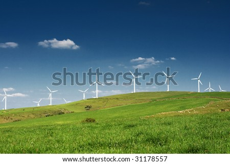 Wind turbines farm. Alternative energy source. - stock photo