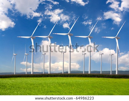 Wind turbines farm. Alternative energy source - stock photo
