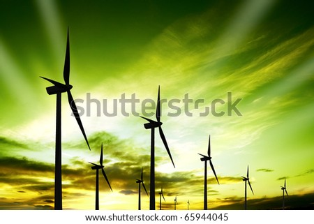 Wind turbines farm at sunset