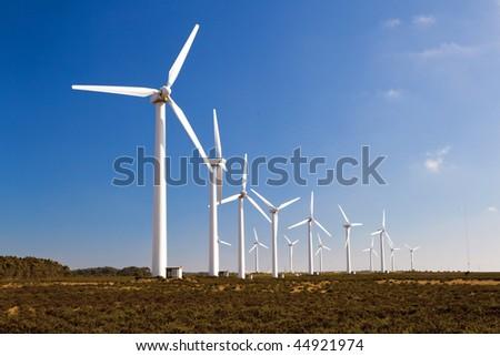 Wind-turbines farm generating clean power energy - stock photo
