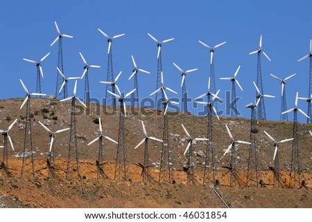 Wind-turbines farm generating clean power energy - stock photo