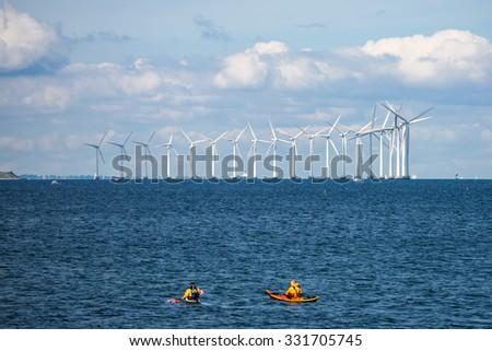 Wind Turbines Farm in Baltic Sea, Denmark - stock photo