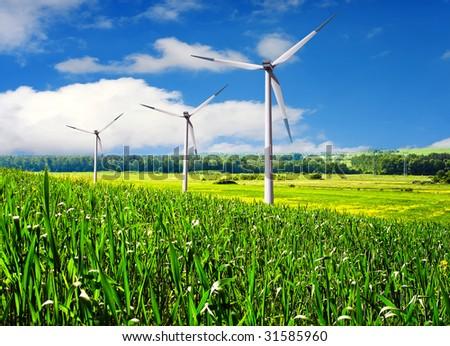 Wind turbines farm in summer - stock photo