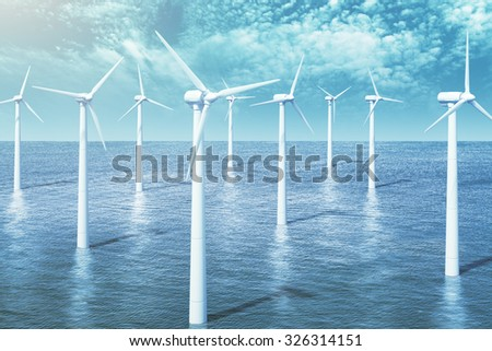 Wind turbines farm in the ocean - stock photo