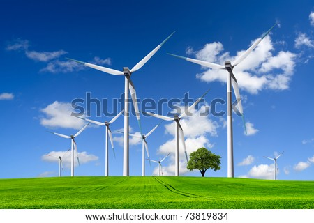 Wind turbines farm on green field - stock photo