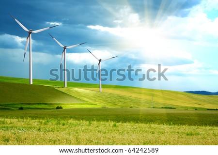 Wind turbines farm on green island - stock photo