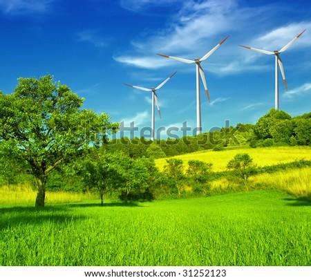 Wind turbines farm on hill in summer - stock photo