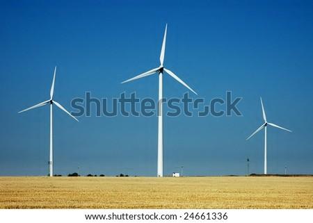 Wind turbines farm - renewable energy source - stock photo