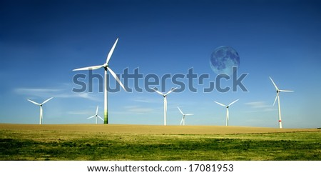 Wind turbines farm with full moon. Alternative energy source. - stock photo