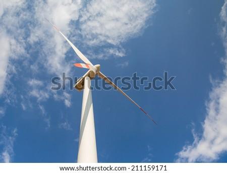 Wind turbines generating electricity  - stock photo