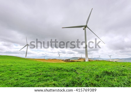 Wind turbines generating electricity. - stock photo