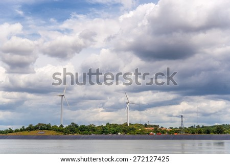 Wind turbines generating electricity in cloudy day