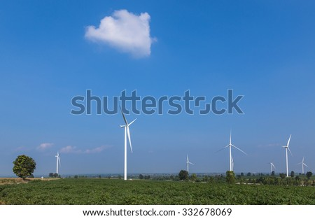 wind turbines generating electricity on blue sky background