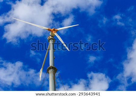 Wind turbines generating electricity on mountain with blue sky at Koh Larn, Pattaya, Chonburi, Thailand
