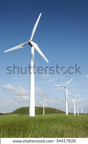 Wind turbines green landscape - stock photo