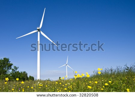 Wind turbines in a field. Demonstrating the power of green, natural, renewable energy. - stock photo