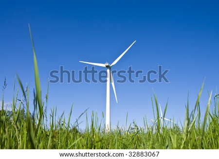 Wind turbines in a field. Modern day windmills producing green energy.