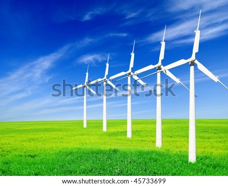 wind turbines in a green field