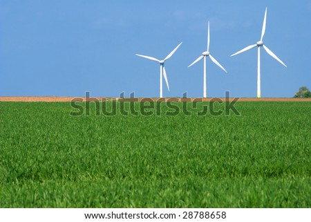 Wind turbines in a green landscape - stock photo