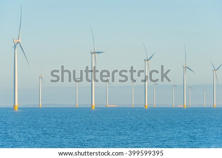 Wind turbines in a lake at sunrise