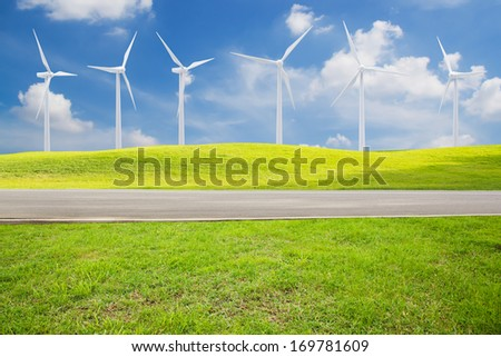 Wind turbines in a meadow. Alternative energy. - stock photo