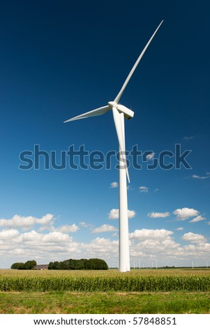 Wind turbines in Dutch agriculture landscape in summer - stock photo