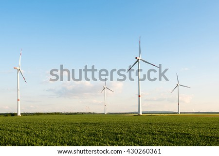 Wind turbines in front of a coal-fired plant in the Ruhr Area in Germany, a very industry intense section with large brown coal mines now setting up wind turbines to cover the enery consumption in a - stock photo