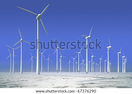 Wind turbines in frozen water, offshore park for energy - stock photo