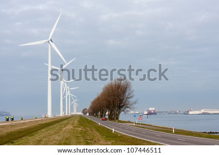 Wind turbines in harbor of Rotterdam, the Netherlands - stock photo