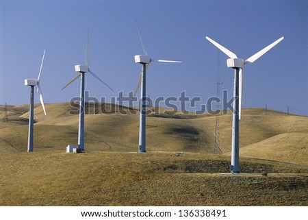 Wind turbines in line - stock photo