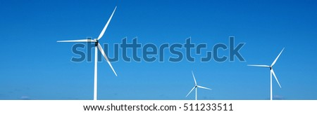 Wind turbines in mid spring at Agighiol commune, Tulcea county, Romania, Eastern Europe