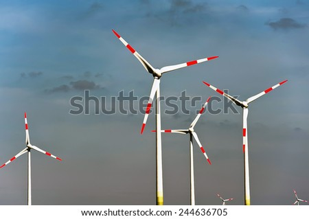Wind turbines in the blue sky  - stock photo