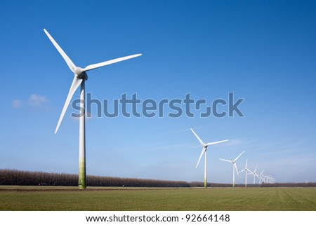 Wind turbines in the farmland of Flevoland, the Netherlands - stock photo
