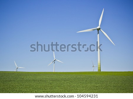 Wind turbines in the field - a renewable energy source - stock photo