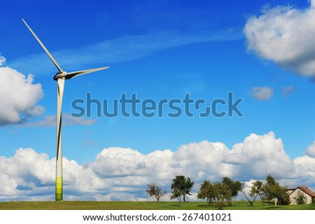 wind turbines in the fields under blue sky - stock photo