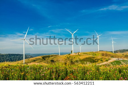 Wind turbines in the  morning light under blue sky background .