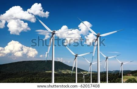 Wind turbines in the mountain - stock photo
