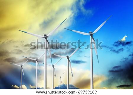 Wind turbines in the sun - stock photo