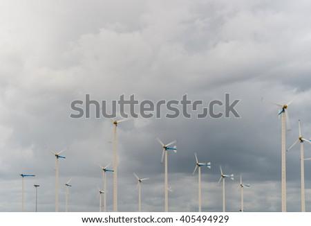 Wind Turbines in wind farm  - stock photo
