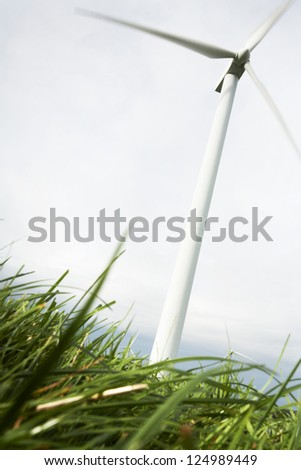 Wind Turbines in wind farm field - stock photo