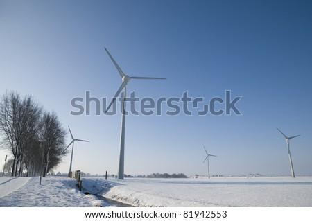 Wind turbines in winter landscape - stock photo