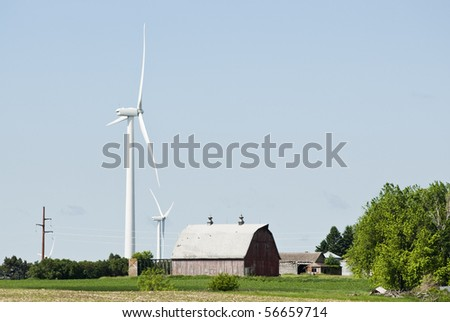 wind turbines located on farmland near Lake Benton Minnesota with transmission lines in the background - stock photo