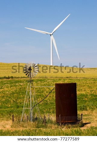 Wind turbines old and new - stock photo