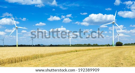 Wind turbines on a agriculture cornfield with cloudy sky Alternative Energy - stock photo