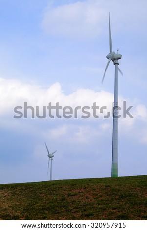 Wind turbines on a field near Pr�¼m, Rheinland-Pfalz, Germany. Spring evening. - stock photo