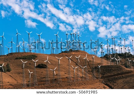 Wind turbines on a hill - stock photo