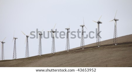 Wind turbines on a hillside.