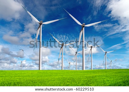 Wind turbines on blue sky - stock photo