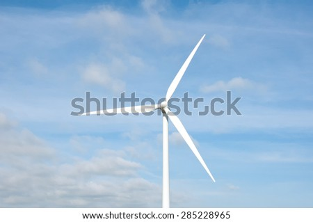 Wind turbines on blue sky background  - stock photo
